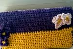 Portafoglio ricoperto in cotone e fiori crochet