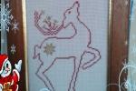 Quadretto natalizio con renna ricamata a punto croce