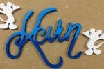 Scritte in legno traforate a mano