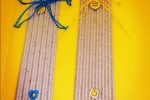 Segnalibri handmade in cartoncino con particolari in metallo e fiocchi