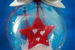 Sfera trasparente contenente stella rossa