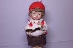Statuetta 12 cm bambino con cappello natalizio