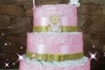 Torta pannolini in tonalità rosa
