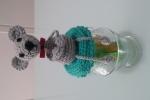 Vasetto di vetro con coperchio decorato