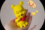 Winnie the pooh in gesso ceramico